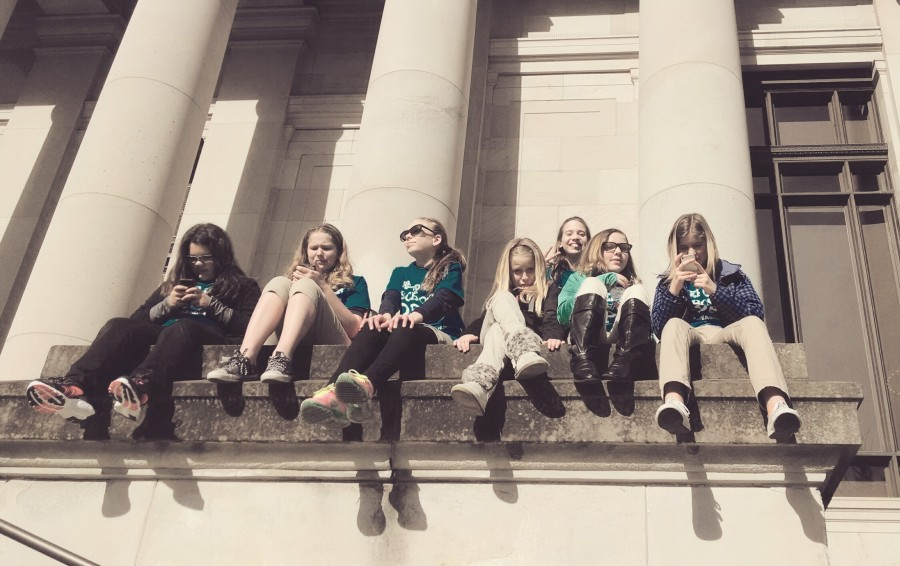 middle-school girls sit on Capitol steps