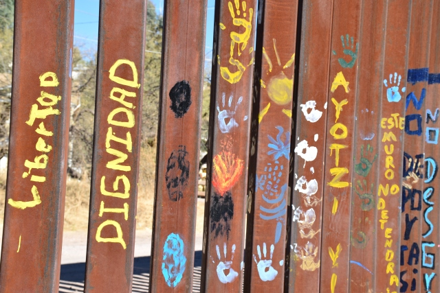 Liberty and Dignity are painted on The Wall - border in Nogales, Mexico